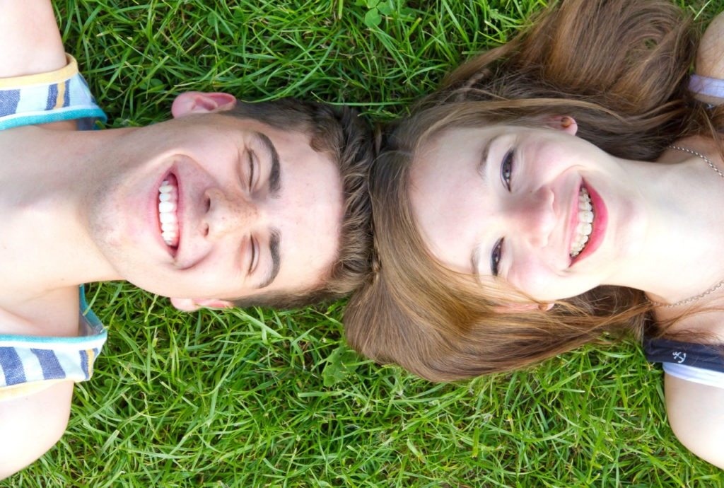 couple smiling in grass
